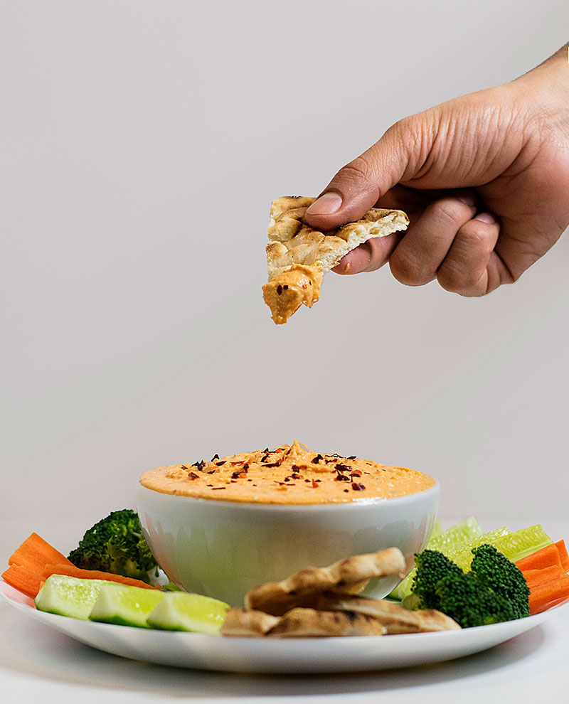 spicy-feta-cheese-dip-with-red-horn-peppers-sauce-pita-bread-brocoli-carrots-yogurt-2