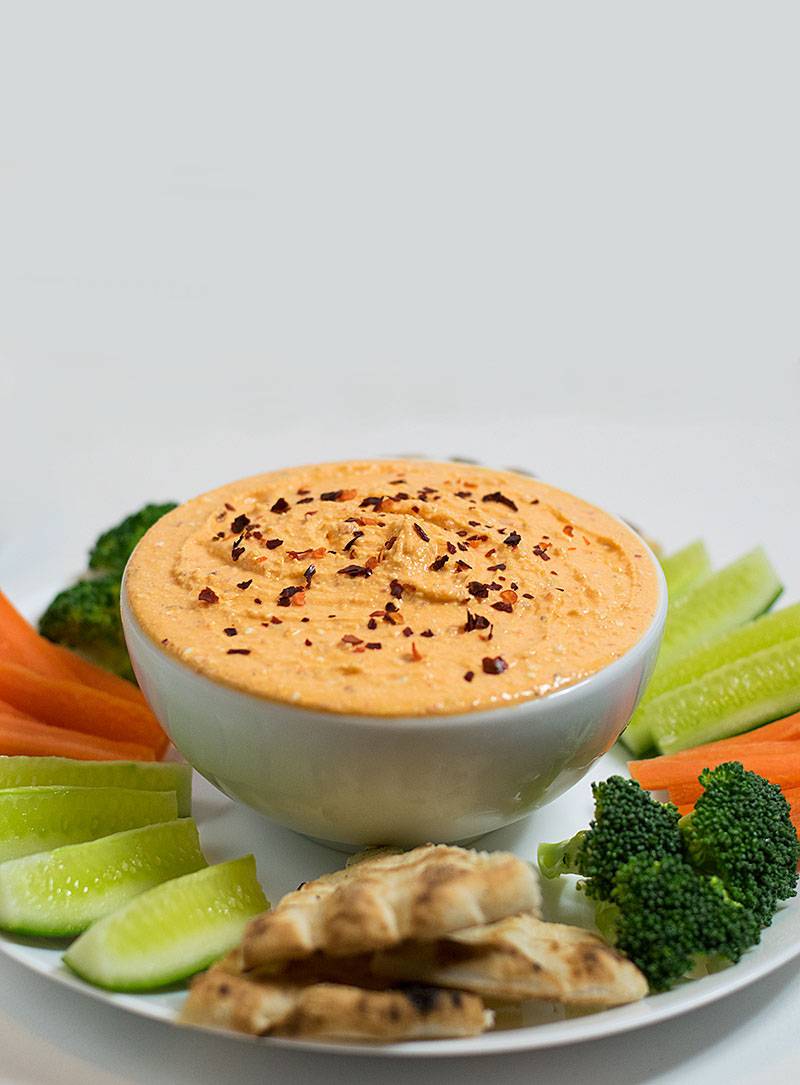 spicy-feta-cheese-dip-with-red-horn-peppers-sauce-pita-bread-brocoli-carrots-yogurt