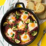 shakshuka with sausage and vegetable sauce