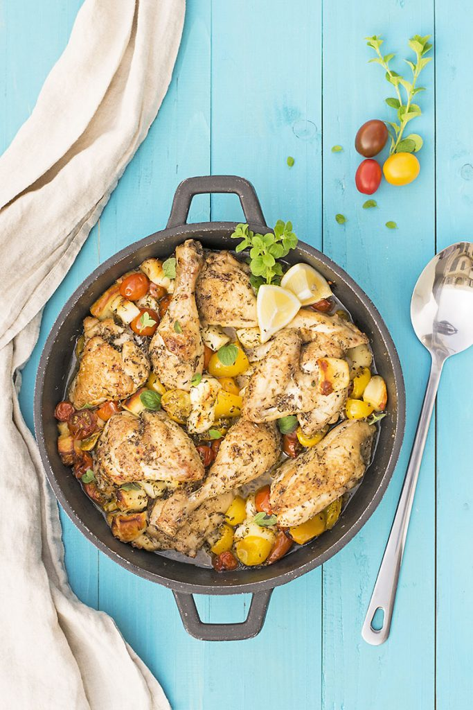 Baked Greek chicken with haloumi and heirloom tomatoes