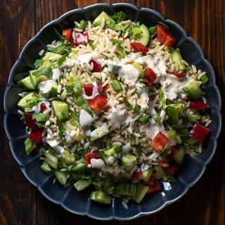 Healthy brown rice salad with lemon – tahini dressing feat